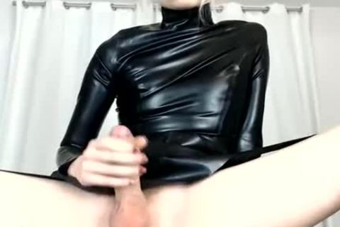 Trap Wears Latex And Shows large rod