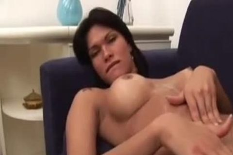 busty brunette brutaly On A Sofa